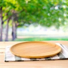 Empty round wooden tray and napery on table over blur tree background, for food and product display montage, template Premium Photo Food Background Wallpapers, Food Backgrounds, Photo Backgrounds, Round Wooden Tray, Food Cartoon, Food Illustrations, Cute Food, Vide, Modern Restaurant
