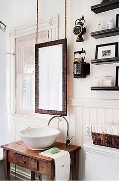 Love the idea of suspending a mirror above the bathroom sink.