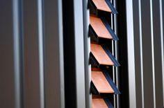 COLORSTEEL® prepainted steel in Ebony with cedar louvres. Blundell residence, by Studio MWA ltd.