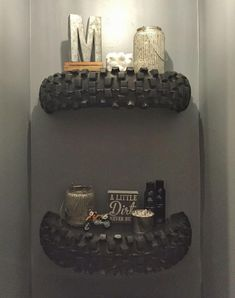Dirtbike tire shelves we made and mounted above our toilet! #Mancaveideas #mancave
