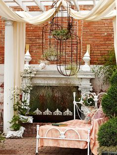 Adorn your patio space with Iron hanging baskets or a birdcage, with potted plants. Love this