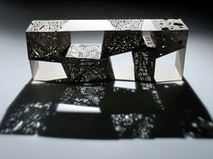 Steven Holl,Riddled Cabinet 2006  Lasercut Canaletto Walnut and aluminum with vegetal oil finish