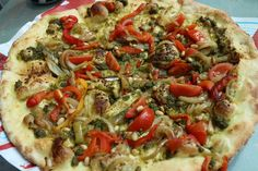 """My """"pesto pasta"""" pizza :) pesto base, cherry tomatoes, roasted onions, roasted peppers, pine nuts and I added chilli and sea salt at Altpizza. Yum."""
