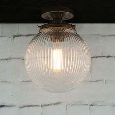 The Large Mullan Stanley Holophane 20cm Globe Ceiling Fitting is a great way to add a discreet touch of sophistication to any room.