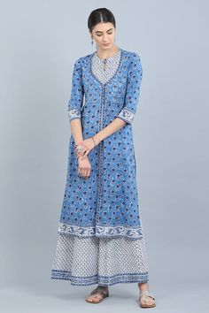 Another opulent piece from our latest Niloufar collection is the Niloufar Shazia Kurta. This straight kurta stands out for its double-yoke design and bright colour combination of blue and white. The water-lily print runs through the entire length of the k