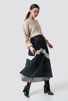 45db857d The Blocked Midi Skirt by NA-KD Trend features a midi length, pleated design