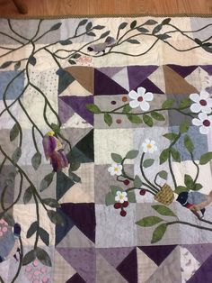 using Japanese fabrics, hand quilting and needle turn hand applique. by Irene Schreiber.