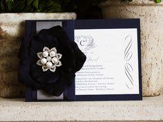 Invitation 724: Navy Pearl, Cream Smooth, Origins, High Tower, Black Ribbon, Charcoal Ribbon, Brooch
