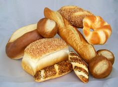 Large Assorted Fake Bread & Roll Package - 11 Piece Set of Breads & Rolls  11 Pieces of assorted fake breads & fake rolls  A variety of larger artificial bread loaves & rolls.  Items may vary depending upon availability. Substitutions will be of the same or higher value. Artificial breads are soft to the touch