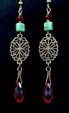 Beautiful antiqued brass earrings w/turquoise beads & red Swarovski briolette
