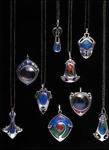 Archibald Knox Pendants A collection of handmade pendants with chain, set with translucent hand enamelling. Originally retailed by Liberty of London circa 1900