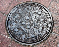 Manhole cover with Lady's Slipper Design in Minneapolis
