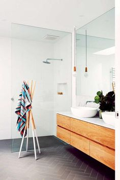 White walls, grey floor, timber vanity