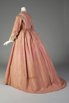 Dress of the day: Salmon taffeta dress with fringe, American, ca. 1865, KSUM 1995.17.543 a-c.  This beautiful dress is currently on exhibit in our Fashion Timeline!