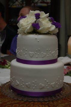 Engagement cake - Two tiers - orange and lemon cake with lemon curd filling and white chocolate buttercream, covered in fondant.  Fondant and royal icing details, ribbon, and fresh flowers.