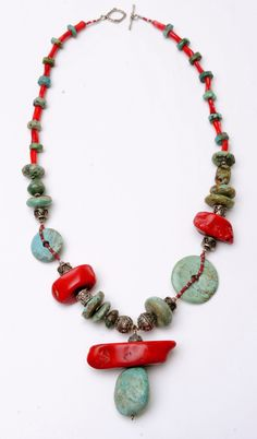 turquoise coral necklace -- i don't like the design but i like some of the pieces