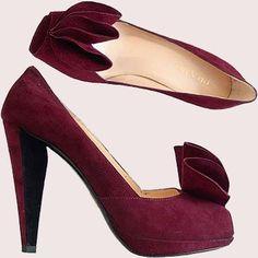 Prada...I`ll wear these with a black pencil skirt or an LBD.;-)