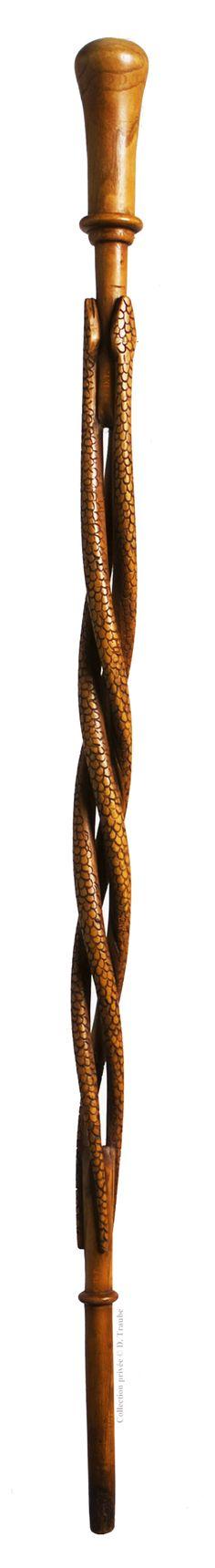 Canne Art Populaire monoxyle - Trois serpents en spirale ajourée - Fin XIXème siècle.