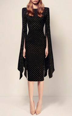 This elegantly designed **Alex Perry** dress features a cutout at the back, a polka dot sequin design throughout, a fitted silhouette with a midi length hemline, and kimono styled sleeves with an exaggerated slit.