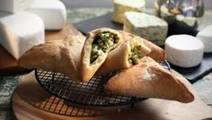 These triangular pasties are based on a Lebanese speciality called fatayer, and use soft bread dough, rather than pastry, to enclose the filling. I like frozen spinach for this recipe – it's very easy to use and actually produces a less watery mixture. Paul Hollywood, Frozen Spinach, Spinach And Feta, Foto Pastel, Nut Recipes, Spinach Recipes, Savoury Recipes, Pastry Recipes, Pie Recipes
