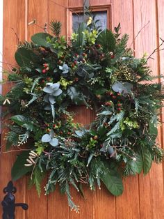 Simply natural and beautiful - made with everything from my garden except the hypericum berries and eucalyptus Christmas Jingles, Woodland Christmas, Christmas Tree Farm, Outdoor Christmas, Rustic Christmas, Christmas Crafts, Christmas Door Hangings, Christmas Wreaths To Make, Christmas Flowers