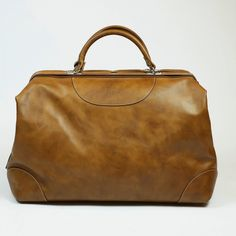 """muaj: """"CALABRESE 1924 Tan Napoli leather travel bag $840.00 $630.00 Calabrese's flagship travel bag : a full leather duffle with a highly practical wide mouth opening reminiscent of doctor's bags"""