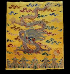 LARGE CHINESE EMBROIDERED SILK DRAGON PANEL, 19th C. Finest yellow satin elaborately and densely embroidered in forbidden or seed stitch, depicting a coiled dragon amid cloud bands over a stylized ocean and rockwork. 70 x 58.