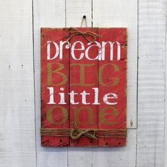 """""""Dream Big"""" Great words to hang in any room of your home. This unique hand-painted, wood sign would also make a great gift for someone in your life who can dream big. This reclaimed wood sign measures"""