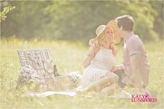A pretty cream lace dress and straw hat look lovely for a summer picnic engagement shoot... bring props too!  Filippa  Darren | Summer Picnic Engagement Shoot » Katy Lunsford Photography