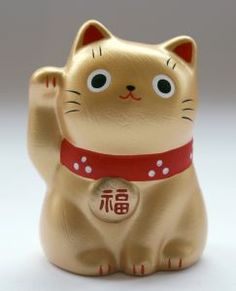 """The Maneki Neko is also known as the """"lucky cat"""", """"welcoming cat"""" and """"beckoning cat"""". From japan, the Maneki Neko is thought to be a symbol of good luck and fortune. Maneki Neko, Neko Cat, Daruma Doll, Good Luck Gifts, Japanese Cat, Cat Decor, Cat Toys, Cat Art, Cats And Kittens"""