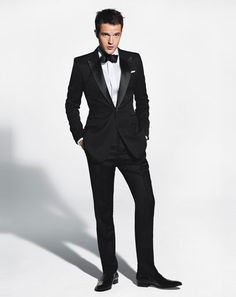 Black dinner jacket with peak lapels.