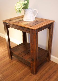 Hand made wooden pallet end table. The table pictured has an early american stain color and can be made to order with no stain and a clear coat or stained to the buyers preference. Dimensions :20 1/2 L X 14 1/2 W X 22 1/2 T