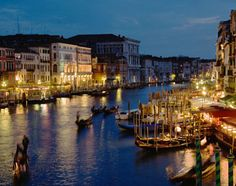 The Grand Canal, Venice, and the cafes and shops that line it, lit up like Christmas after sunset.