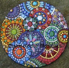 "Claire Roche Mosaics  ""Clockworks"" close up  17"" diameter stained glass millefiori glass beads giant glass globs glitter tile irridescent ovals Color Fusion tile Trend vitreo tile mirror tile"
