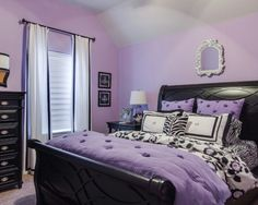 Purple for walls. Black accents. Bedroom 1.