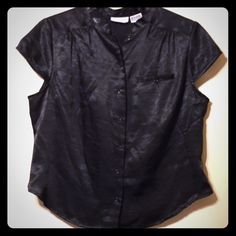 Jaclyn Smith Black Blouse Pretty black button down blouse that has a satin look and feel. Very comfortable and can be dressed up or down. Jaclyn Smith Tops Blouses