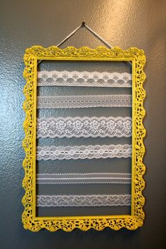 DIY Earring Holder with frame and lace via Crafty Endeavor
