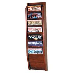 """Showcasing 7 pockets for stowing magazines or mail, this dark red mahogany-finished wall rack offers a simple storage solution for your entryway or library. Product: Wall magazine rackConstruction Material: Wood and solid oak woodColor: Dark red mahogany  Features: Seven pockets  Dimensions: 36"""" H x 10.5"""" W x 3.75"""" D"""