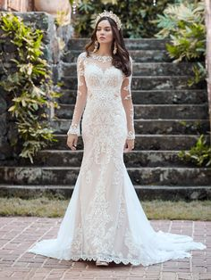 Maggie Sottero - LYDIA ANNE, You're a goddess, and therefore deserve a gorgeous train, customizable sleeve options, and a heavenly silhouette. We present this elegant illusion lace sheath wedding dress for your consideration.