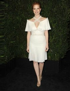 Jessica Chastain attends the Chanel pre-Oscar dinner in a dress from the Spring Summer 13 Couture collection