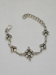 """Delicate faceted White Topaz gemstone clusters, set in 925-hallmarked sterling silver. Length: 6-7""""+ Lobster claw clasp. Widest center vertical dimension: .85"""""""