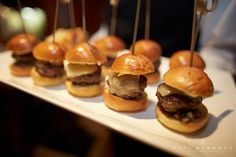 Mini Truffle Cheeseburgers by Festivities Catering... yum! These were part of a cheese and wine tasting party in San Diego. What a great and tasty idea!!! Photography by Paul Barnett.