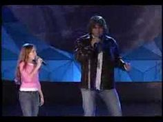 "Billy Ray Cyrus with a cute, young version of our now well-known pop- star...Miley Cyrus (aka Hannah Montana) are singing a beautiful song:""Holding on to a Dream."""