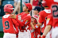 From left to right, Tijuana, Mexico's Jorge Romero, Martin Gonzalez and Jorge Duenas celebrate after Romero's two-run home run during the seventh inning of an elimination baseball game against Aguadulce, Panama. (Matt Slocum/AP)