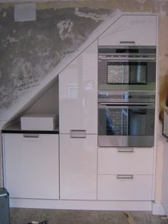 1000 images about awkward understairs kitchens on for Kitchen designs under stairs