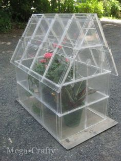 Mega•Crafty: CD Case Greenhouse.  wow I wonder if it would really work?!