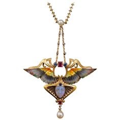 Philippe Wolfers Nike Enamel Ruby Emerald Diamond Gold Pendant   From a unique collection of vintage drop necklaces at https://www.1stdibs.com/jewelry/necklaces/drop-necklaces/
