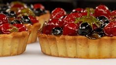 Tender pastry filled with smooth pastry cream and topped with fresh summer berries - a perfect summer treat.