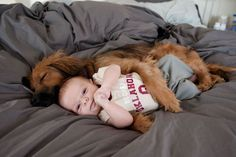 A protective dog spooning with a baby. | 50 Animal Pictures You Need To See Before You Die
