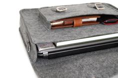Felt Laptop 13 inch bag, satchel, sleeve, macbook pro, macbook air 13 inch sleeve, case, bag with leather strap buckle and belt shoulder. $64.00, via Etsy.